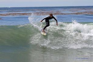 travis surfing